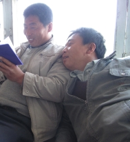 Relaxing in the scripture hall between rituals, Golden Noble and Wu Mei amused by my notebook.